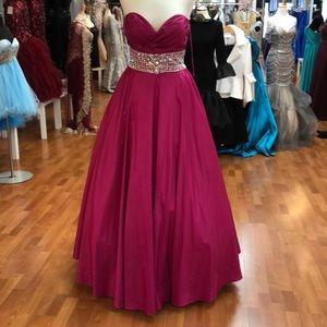 Fuchsia prom dress with rhinestones and beads